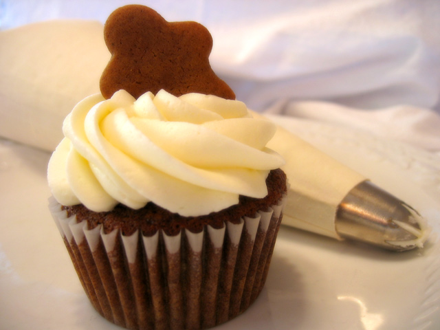 Gingerbread cupcake with vanilla buttercream and optional gingerbread man garnish (see menu)