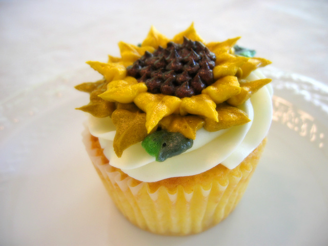 Vanilla cupcake with vanilla buttercream and flower detailing (see menu)